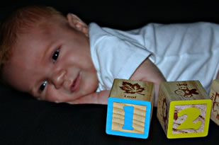 A baby with blocks.